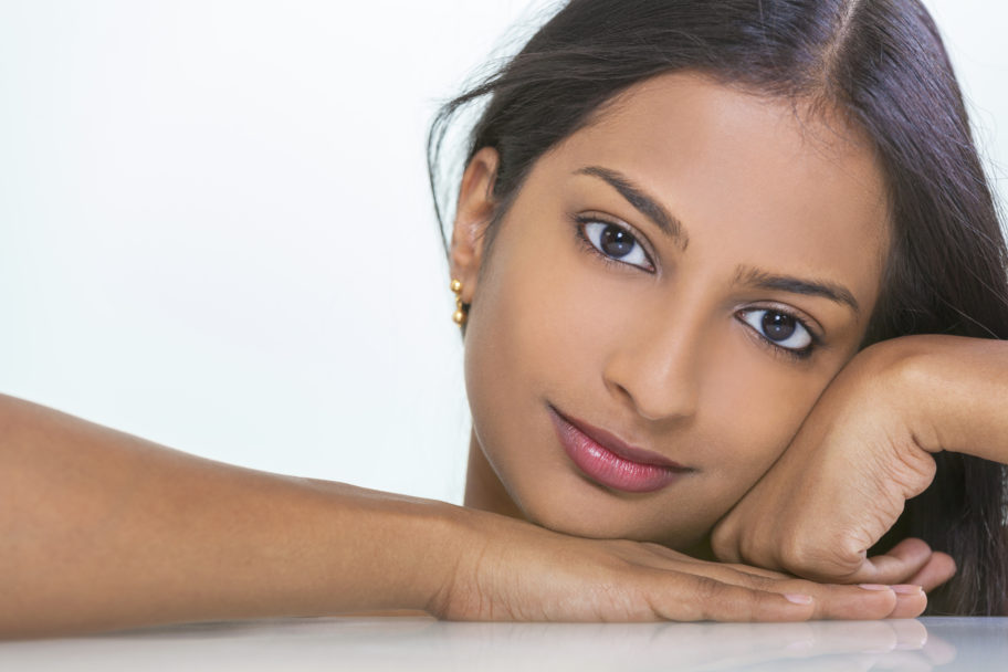 attractive Indian Asian woman with beautiful facial skin