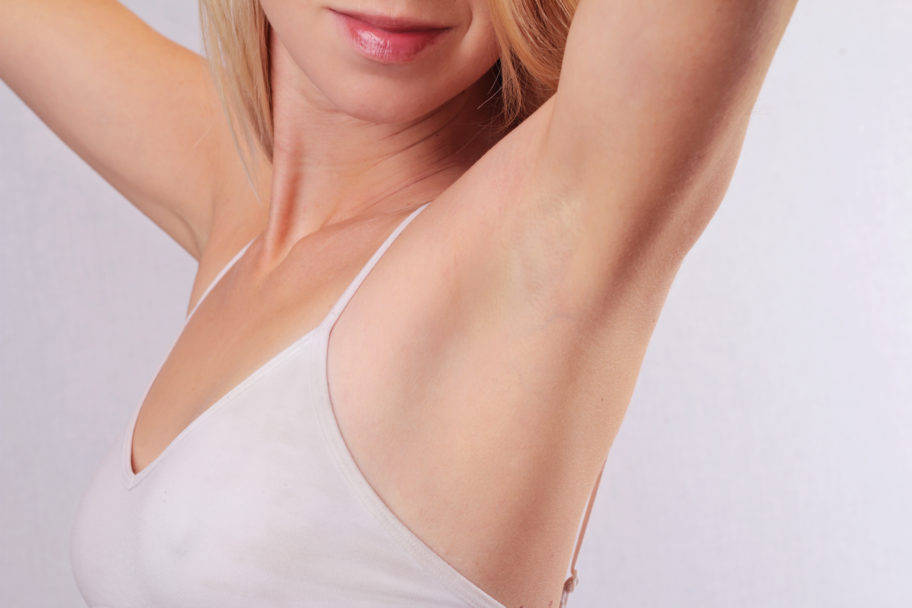 bare hairless underarm of young female