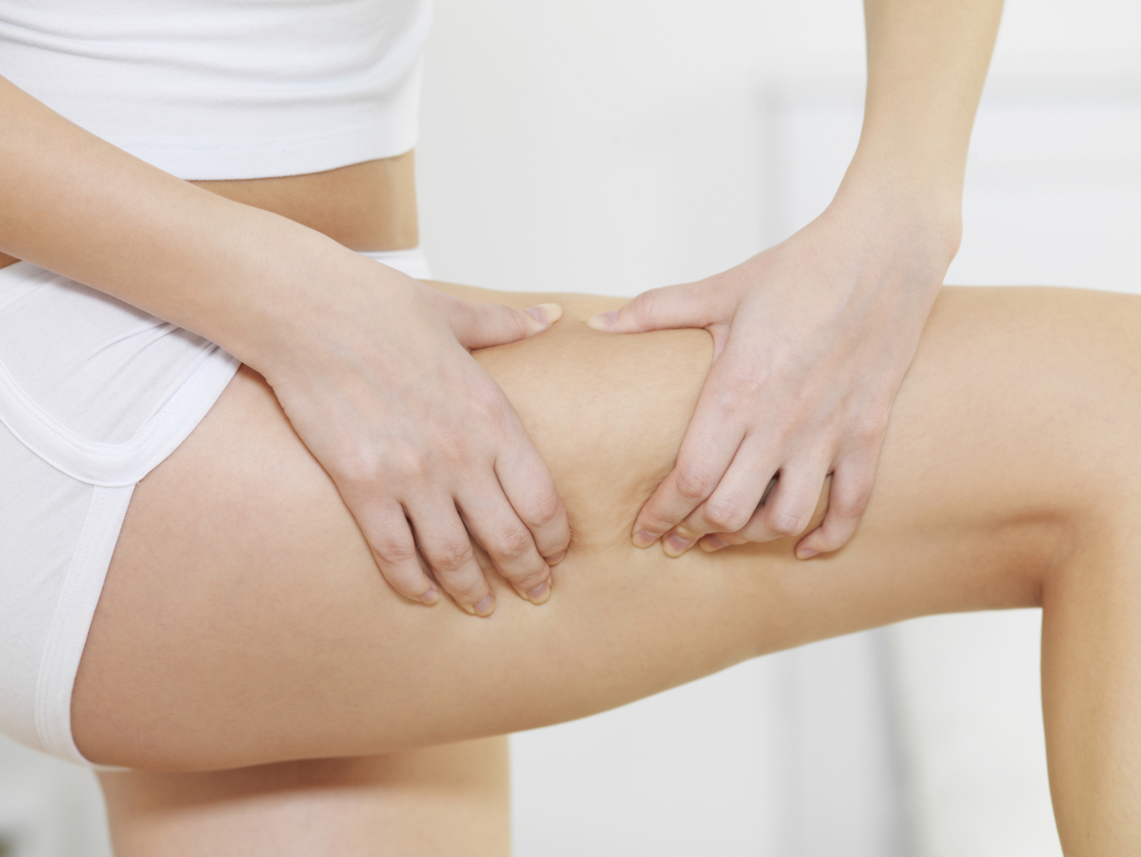 woman touching her beautiful, cellulite-free leg